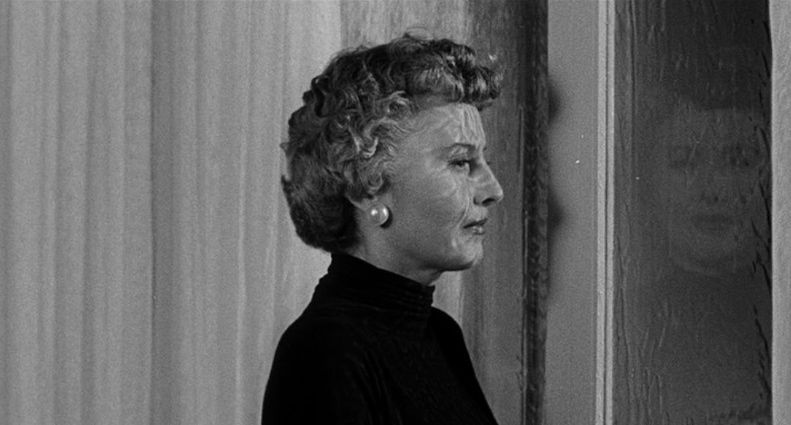 Figure 2: Classic Sirk, from the window to the reflection to the rain.